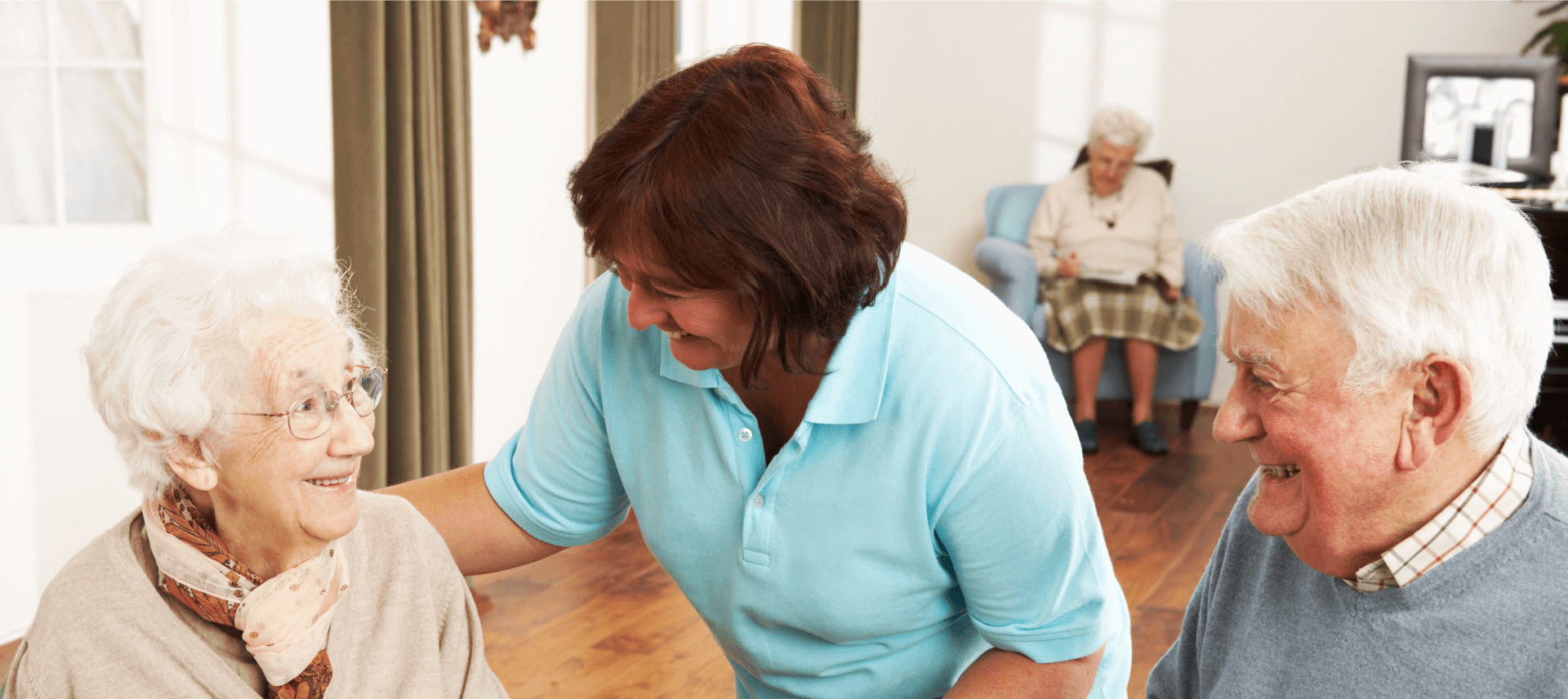 caregiver smiling to elders