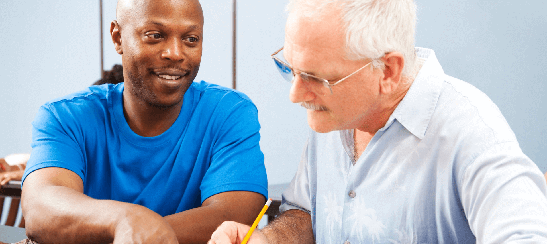 caregiver assisting patient to write