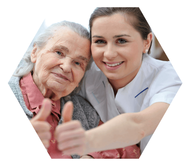 nurse and old woman showing their thumbs up